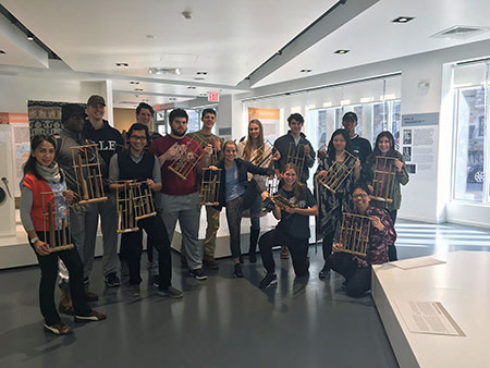 students holding angklung instruments
