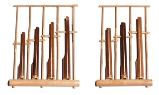 Two angklung instruments, one with 4 tubes and one with three